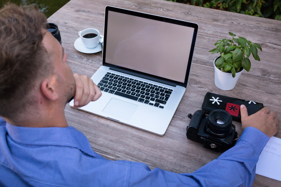 Over the shoulder of a person on a laptop
